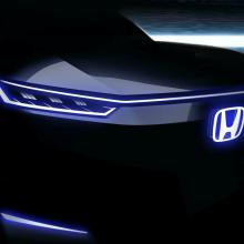 Обалденный новый электромобиль Honda EV демонстрирует свое изящное ''лицо''