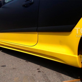 Тюнинг - Пороги Rieger Style на Opel Astra H GTC