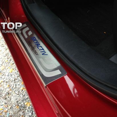 Накладки на внешние пороги  на Mazda
