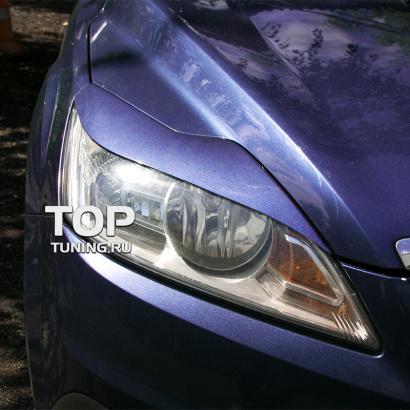 Накладки на переднюю оптику на Ford Focus 2