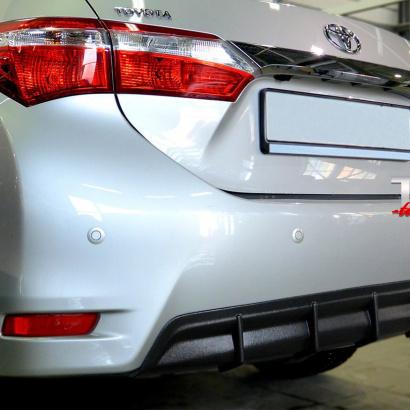 Тюнинг - Диффузор на задний бампер на Toyota Corolla E160