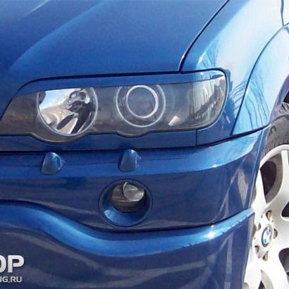 Накладки на переднюю оптику на BMW X5 E53