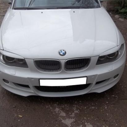 Накладки на передние фары на BMW 1 E81