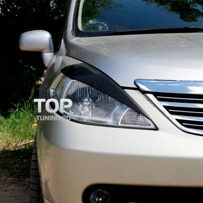 Реснички передние фары на Nissan Tiida