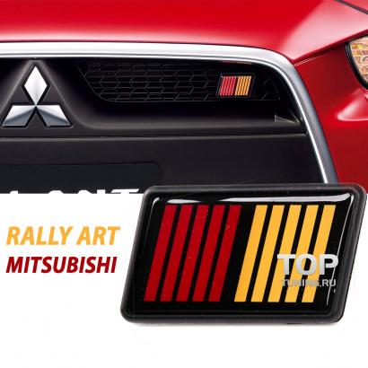 Эмблема в решетку радиатора на Mitsubishi