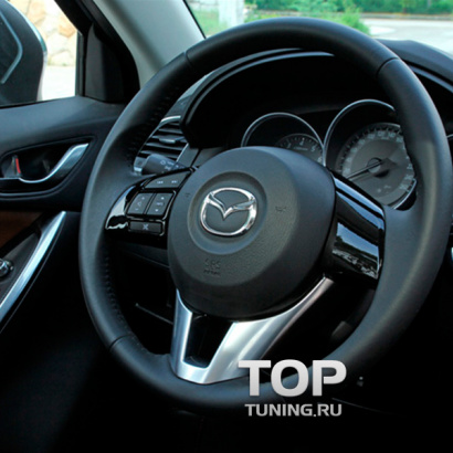 Вставки в руль на Mazda CX-5 1 поколение