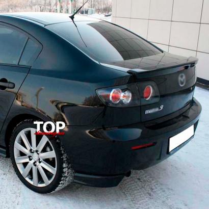 Клыки на задний бампер на Mazda 3 BK