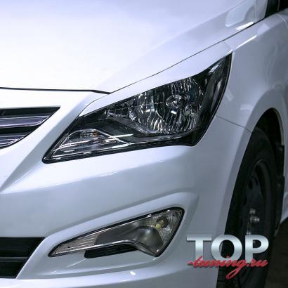 Реснички на передние фары на Hyundai Solaris