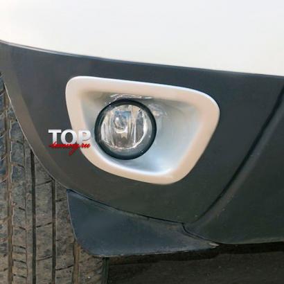 Декоративные облицовки ПТФ на Renault Duster 1