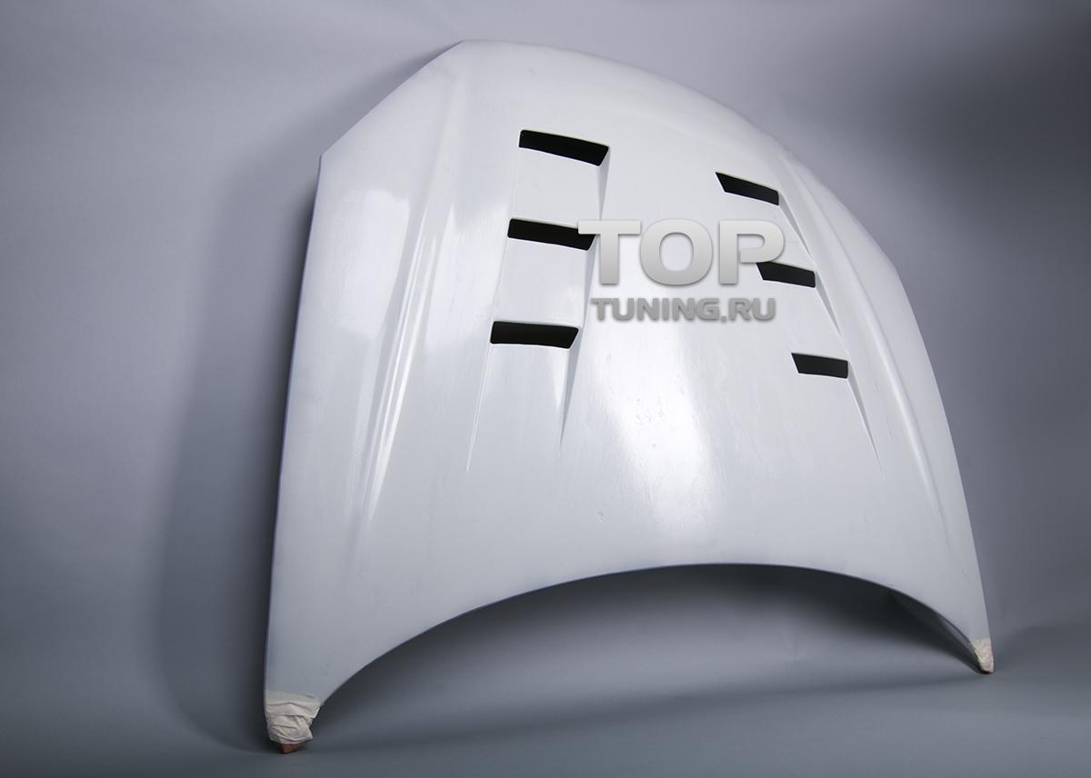 Капот с жабрами Топ Тюнинг на Хендай Купе / Тибурон - рестайлинг.