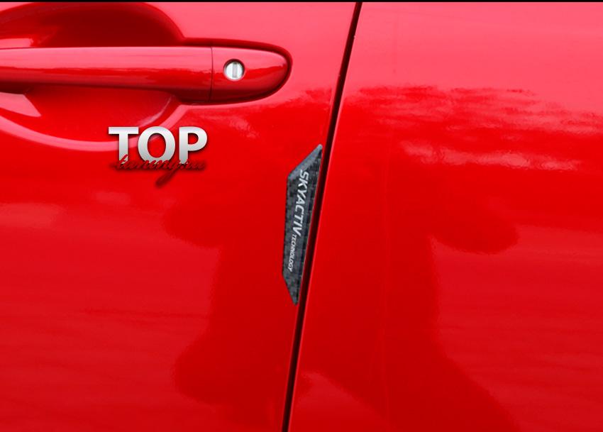 5714 Эмблемы Skyactiv на двери Carbon - 4 шт. на Mazda