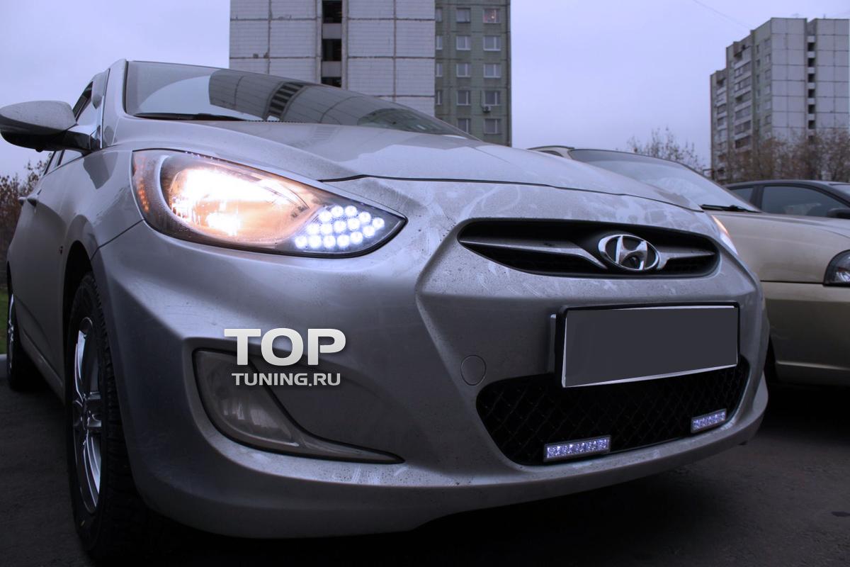 Решетка в бампер на Hyundai Solaris с ходовыми огнями