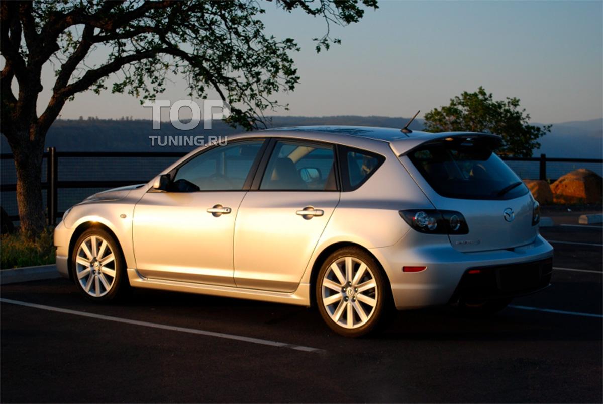 8030 Тюнинг - Пороги Sport на Mazda 3 BK