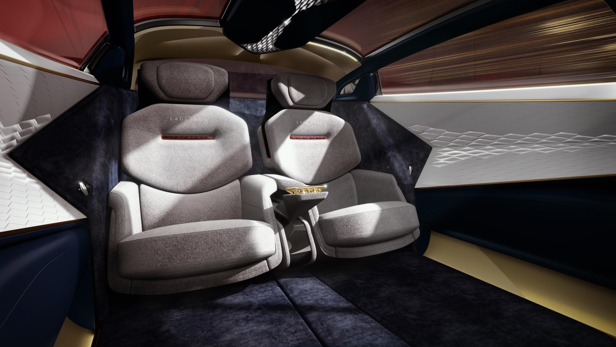 То, что предлагает Lagonda - это роскошный грандиозный автомобиль. Над интерьером работал специалист по мебели Дэвид Линли вместе с экспертом по тканям портным Savile Row Генри Пулом.
