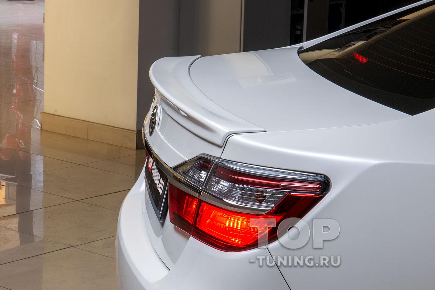 103168 Установка спойлера и козырька для Toyota Camry XV50