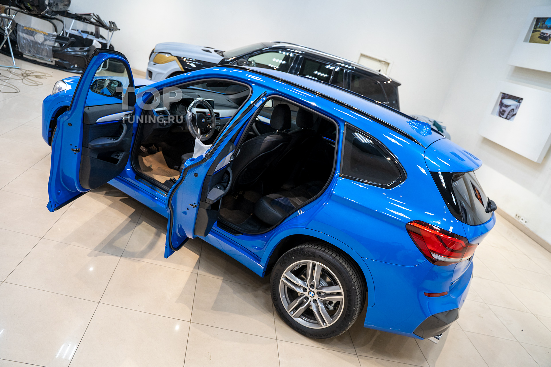 Тонирование окон в БМВ Х1 - задние двери, форточки, стекло багажник