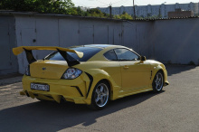 Накладки на задние крылья - расширители Warrior Mussa - Тюнинг Hyundai Coupe.