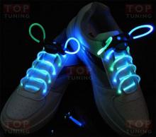Шнурки неоновые со светящимися элементами синего цвета.