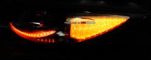 Тюнинг Киа Спортаж - бело-желтые светодиодные модули ресничек фар