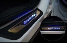 Тюнинг Киа Спортейдж - светодиодные накладки порогов салона.