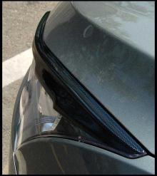 Тюнинг Шевроле Круз - накладки на переднюю оптику и накладки на задние крылья.