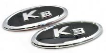 Тюнинг Киа Серато - эмблемы на переднюю, заднюю панели и на клаксон - от компании M&S.