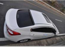 Тюнинг Киа Церато - лип-спойлер на крышку багажника.