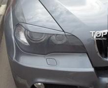 Стайлинг БМВ Х5 (е70) - Накладки на переднюю оптику GT2.