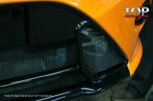 Пример готовой работы по установке мелкой сетки в передний бампер Форд Фокус 2
