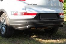 Тюнинг Киа Спортейдж 3 - Юбка заднего бампера Ixion.