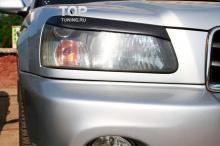 Тюнинг Субару Форестер - Накладки на переднюю оптику RX.