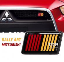 Декоративная эмблема - шильдик в решетку радиатора RALLY ART - Стайлинг Митсубиси - Размер 60 х 35 мм.