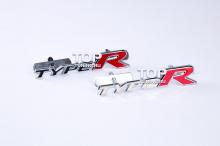 Хромированная эмблема в решетку радиатора на болтах. Модель - TYPE R, тюнинг HONDA. 2 цвета на выбор.  Черный и белый. Длина шильдика 15 см.