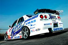 6199 Задний бампер Uras на Nissan Skyline R34