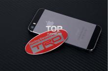 Тюнинг эмблема ТРД (TRD) Toyota Racing Development - Овал с зеркальными буквами - Размер 80 * 38 мм.