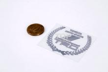 Самоклеющийся стикер Герб TRD из никелевого сплава, на монтажной основе. Размер 55 * 44 мм.
