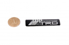 Эмблема наклейка TRD в эластичной смоле, на карбоновой основе. Размер 62*16 mm.