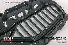 Изготовленные отдельно - эмблема и ламели воздухозаборников решетки установлены в специальные углубления и зафиксированы креплениями изнутри.