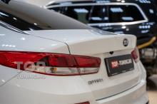 Kia Optima 4 белого цвета перед установкой спойлера Адванс