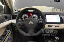 106065 Установка анатомического руля Ego Skill на Mitsubishi Lancer X